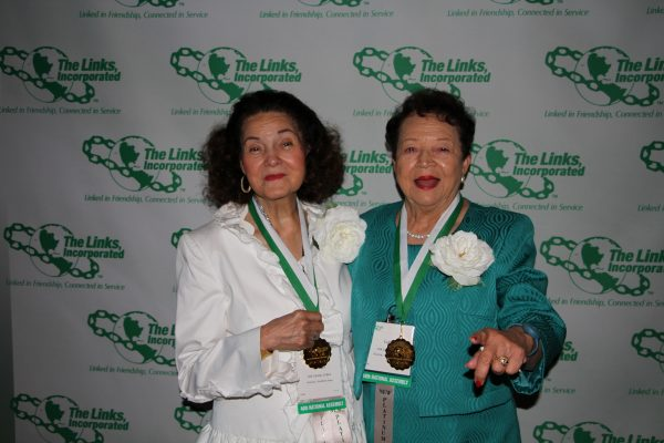 Carolyn Collins and Lula Thorpe being honored as for all their years of service as Links